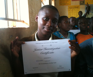 Photograph of a school student holding a certificate